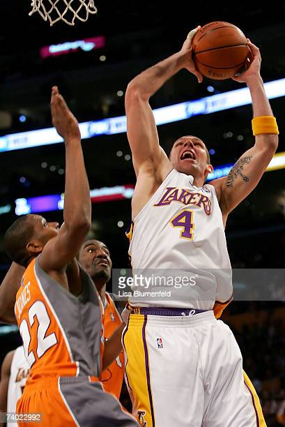 Luke Walton of the Los Angeles Lakers goes to the basket over James Jones and Amare Stoudemire of the Phoenix Suns in Game Four of the Western...