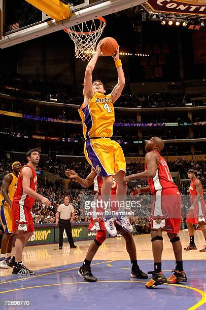 Luke Walton of the Los Angeles Lakers goes to the hoop past the Atlanta Hawks at Staples Center on December 8 2006 in Los Angeles California The...