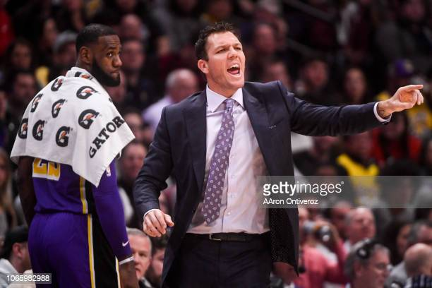Luke Walton of the Los Angeles Lakers shouts instructions as LeBron James stands behind him during the first half against the Denver Nuggets on...