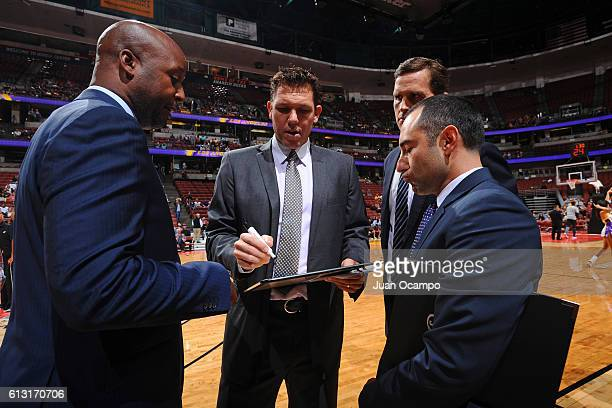Luke Walton of the Los Angeles Lakers speaks with his coaching staff during a preseason game against the Sacramento Kings at the Honda Center on...