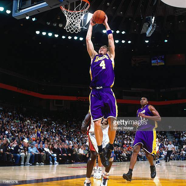 Luke Walton of the Los Angeles Lakers takes the ball to the basket during a game against the Golden State Warriors at the Oracle Arena in Oakland on...