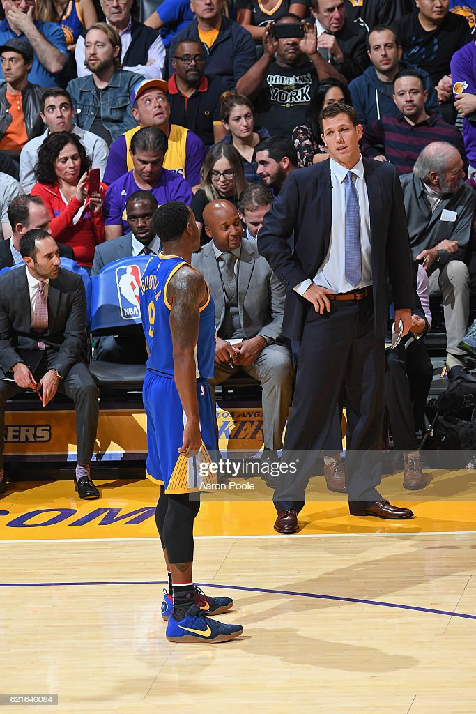 Luke Walton of the Los Angeles Lakers talks to Andre Iguodala #9 of the Golden State Warriors during the game on November 4, 2016 at STAPLES Center in Los Angeles, California.