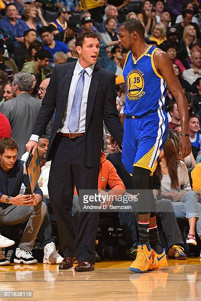 Luke Walton of the Los Angeles Lakers talks to Kevin Durant of the Golden State Warriors during the game on November 4 2016 at STAPLES Center in Los...