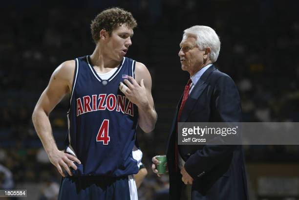 Luke Walton of the University of Arizona Wildcats talks to his head coach Lute Olson during the game against the UCLA Bruins at Pauley Pavilion on...