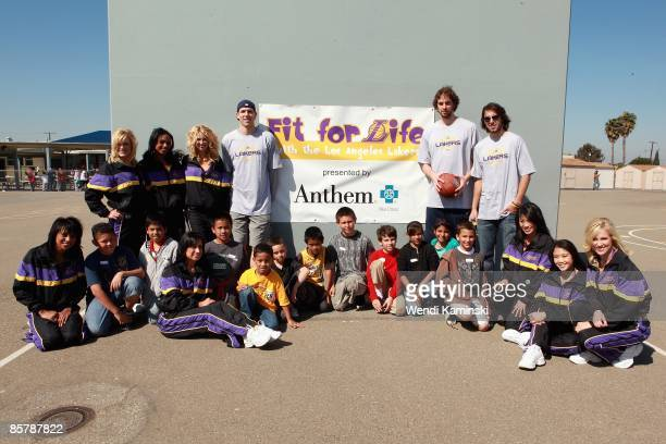Luke Walton Pau Gasol and Sasha Vujacic of the Los Angeles Lakers and the Laker Girls poses with students during Anthem Blue Cross's 'Fit for Life'...