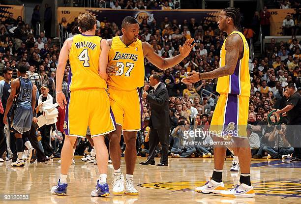 Luke Walton Ron Artest and Josh Powell of the Los Angeles Lakers celebrate a play against the Memphis Grizzlies during the game on November 6 2009 at...