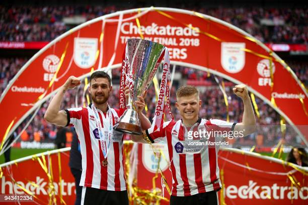 Luke Waterfall and Elliot Whitehouse of Lincoln lift the trophy with his teammates after victory during the Checkatrade Trophy Final between...