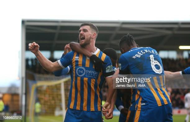 Luke Waterfall of Shrewsbury Town celebrates with his team mates after scoring a goal to make it 20 during the FA Cup Fourth Round match between...