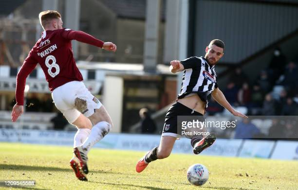 Luke Waterfull of Grimsby Town challenges for the ball with Ryan Watson of Northampton Town during the Sky Bet League Two match between Grimsby Town...