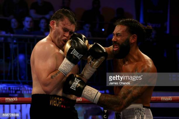 Luke Watkins of England punches Robin Dupre of England during there Commonwealth Cruiserweight Title fight at York Hall on October 7, 2017 in London,...
