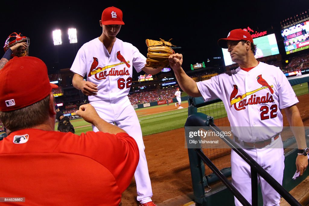Luke Weaver #62 of the St. Louis Cardinals is congratulated by manager Mike Matheny #22 of the St. Louis Cardinals after pitching against the Pittsburgh Pirates in the fourth inning at Busch Stadium on September 8, 2017 in St. Louis, Missouri.