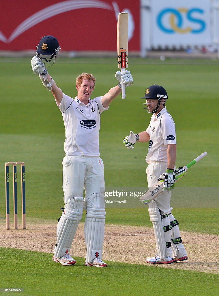 Luke Wells of Sussex celebrates his century with team mate Ed Joyce during day two of the LV County Championship Division One match between Surrey and Sussex at The Kia Oval on April 25, 2013 in London, England.