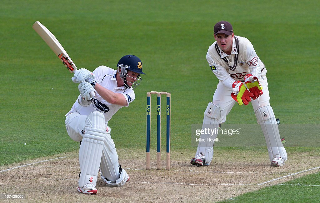 Luke Wells of Sussex hits out as wicketkeeper Steve Davies of Surrey looks on during day two of the LV County Championship Division One match between Surrey and Sussex at The Kia Oval on April 25, 2013 in London, England.