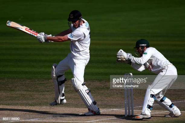 Luke Wells of Sussex hits out while Nottingham keeper Chris Read looks on during day four of the Specsavers County Championship Division Two match...