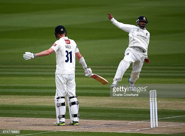 Luke Wells of Sussex looks on as he is caught out by the celebrating Ateeq Javid of Warwickshire during day three of the LV County Championship match...