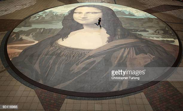 Luke Wharton-Jones, aged eight, runs across the world's biggest copy of the Mona Lisa during a photocall for its unveiling on October 28, 2009 in...