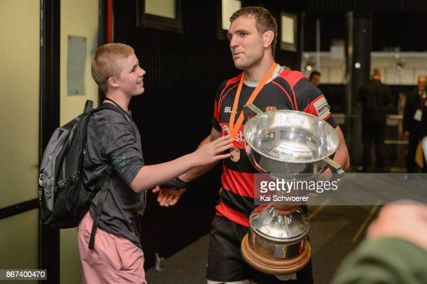 Luke Whitelock of Canterbury is congratulated by a fan after the win in the Mitre 10 Cup Premiership Final match between Canterbury and Tasman at AMI...