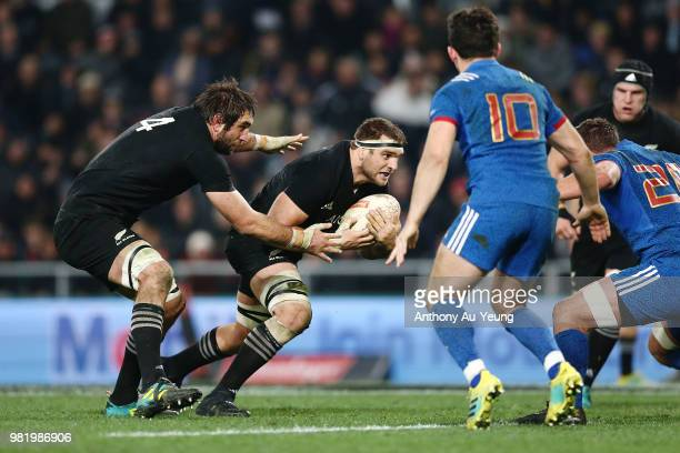 Luke Whitelock of the All Blacks on the charge with brother and teammate Sam Whitelock in support during the International Test match between the New...