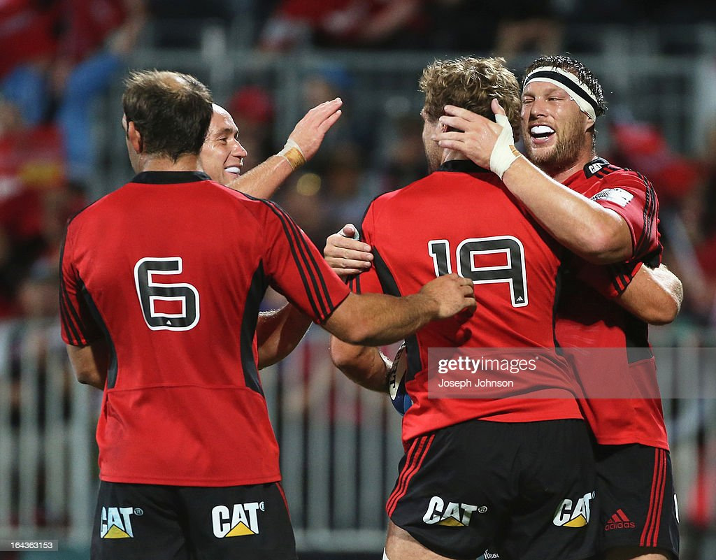 Luke Whitelock of the Crusaders is congratulated by Wyatt Crockett George Whitelock and Willie Heinz during the round six Super Rugby match between the Crusaders and the Kings at AMI Stadium on March 23, 2013 in Christchurch, New Zealand.