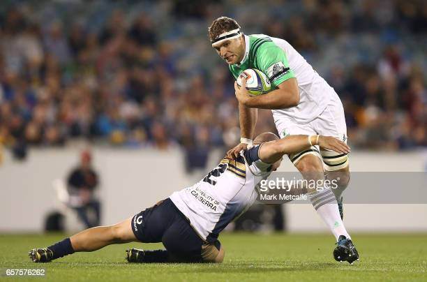 Luke Whitelock of the Highlanders is tackled by Robbie Abel of the Brumbies during the round five Super Rugby match between the Brumbies and the...
