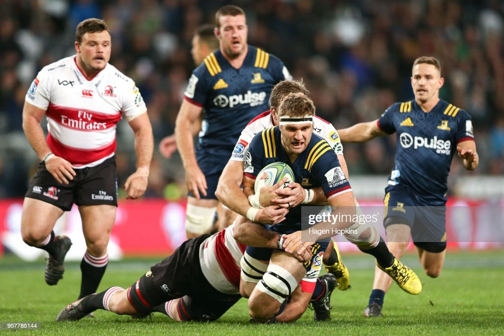 Luke Whitelock of the Highlanders is tackled during the round 12 Super Rugby match between the Highlanders and the Lions at Forsyth Barr Stadium on May 12, 2018 in Dunedin, New Zealand.