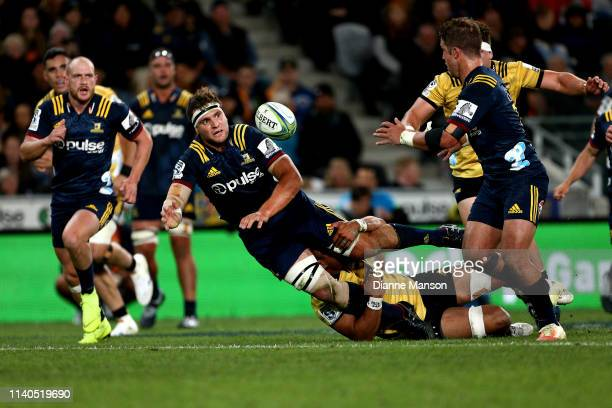 Luke Whitelock of the Highlanders passes the ball during the round 8 Super Rugby match between the Highlanders and Hurricanes at Forsyth Barr Stadium...
