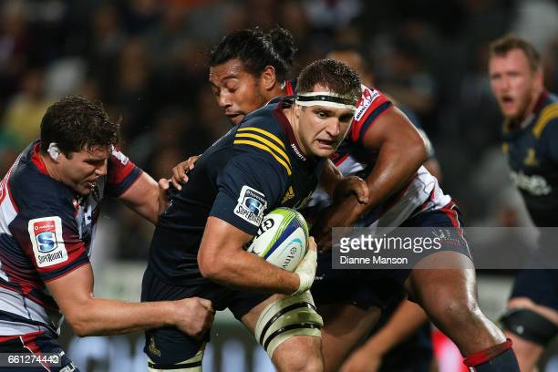 Luke Whitelock of the Highlanders tries to break the defence during the round six Super Rugby match between the Highlanders and the Rebels at Forsyth...