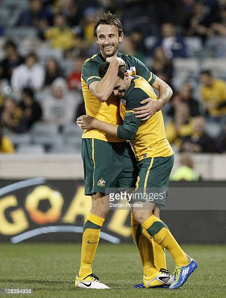 Luke Wilkshire and Josh Kennedy of Australia celebrate after Josh Kennedy scored a goal during the International Friendly match between the...