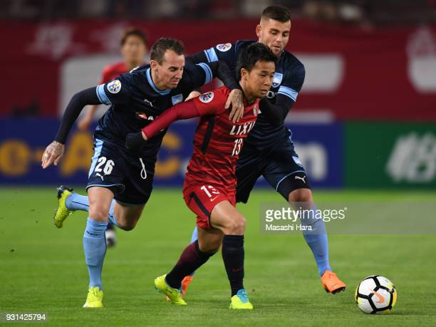 Luke Wilkshire Christopher Zuvela of Sydney FC and Atsutaka Nakamura of Kashima Antlers compete for the ball during the AFC Champions League Group H...