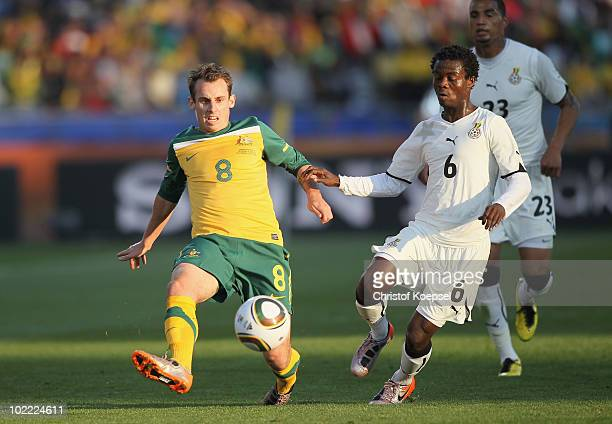 Luke Wilkshire of Australia and Anthony Annan of Ghana battle for the ball during the 2010 FIFA World Cup South Africa Group D match between Ghana...
