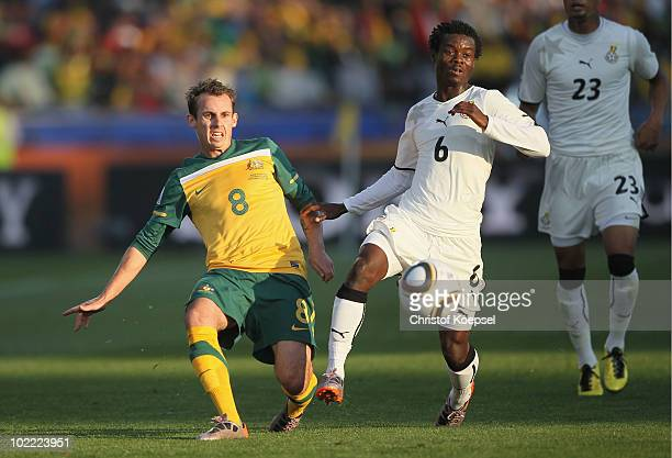 Luke Wilkshire of Australia and Anthony Annan of Ghana in action during the 2010 FIFA World Cup South Africa Group D match between Ghana and...