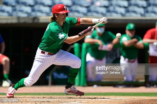 Luke Williams of the Philadelphia Phillies squares to bunt during the second inning against the Detroit Tigers during a spring training game at...