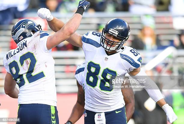 Luke Willson and Jimmy Graham of the Seattle Seahawks celebrates after Wilson caught a touchdown pass against the San Francisco 49ers during the...