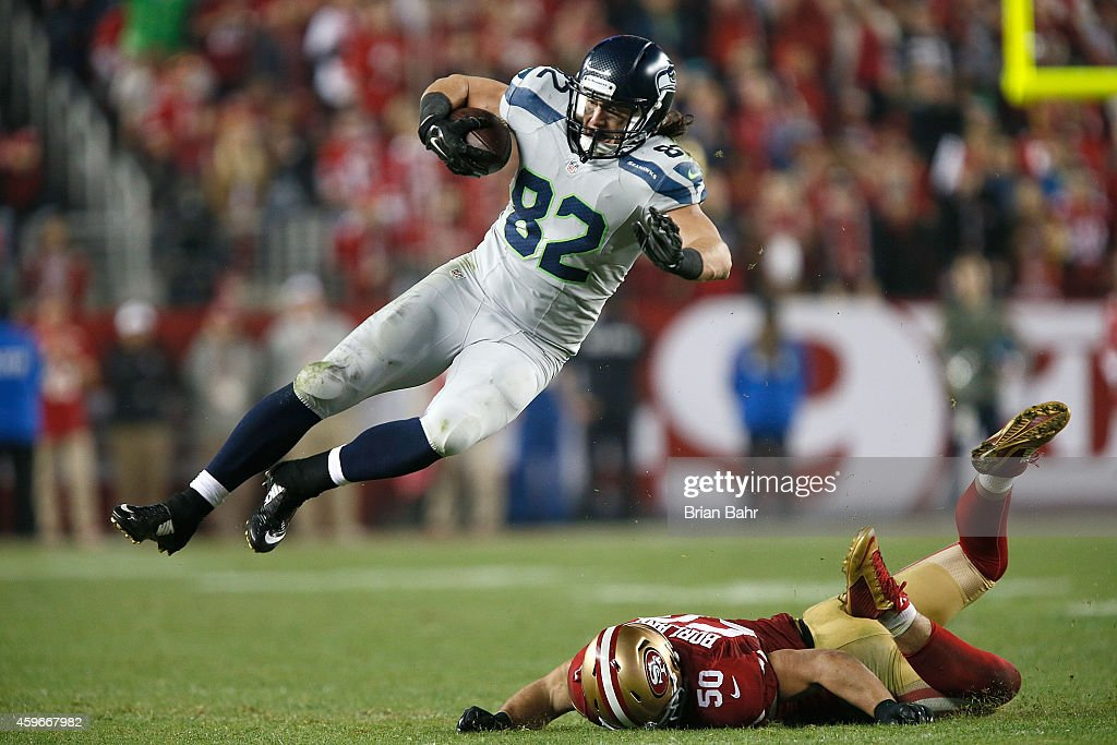 Luke Willson #82 of the Seattle Seahawks avoids the tackle from Chris Borland #50 of the San Francisco 49ers in the second half at Levi's Stadium on November 27, 2014 in Santa Clara, California.