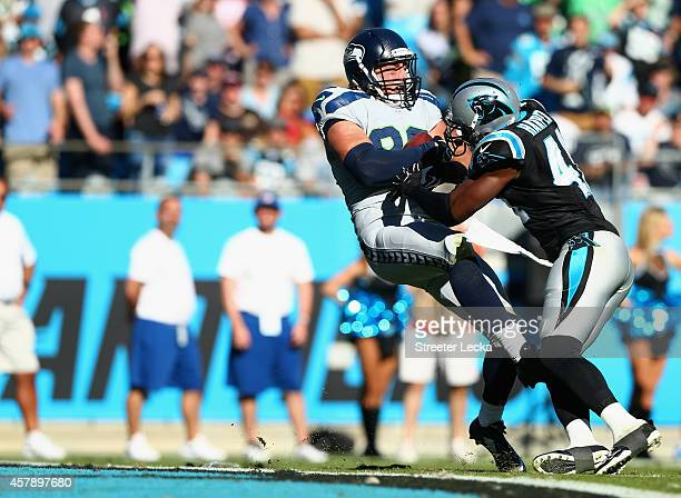 Luke Willson of the Seattle Seahawks catches the game winning touchdown against the Carolina Panthers during the game at Bank of America Stadium on...