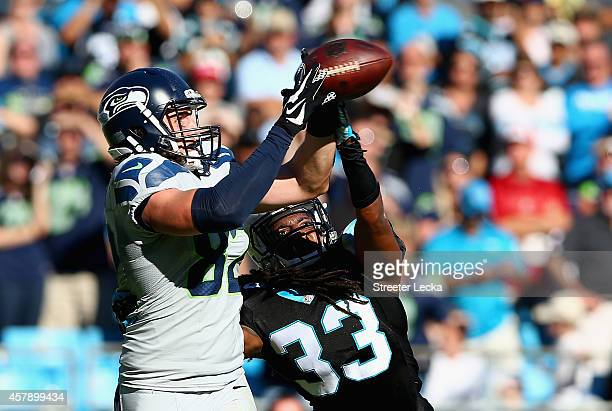 Luke Willson of the Seattle Seahawks catches the game winning touchdown against Tre Boston of the Carolina Panthers during the game at Bank of...