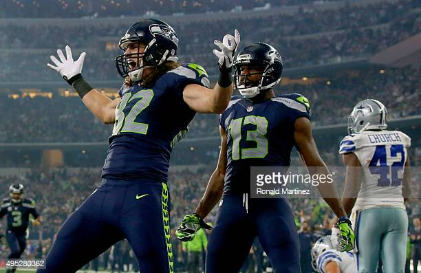Luke Willson of the Seattle Seahawks celebrates as teammate Chris Matthews looks on after scoring a touchdown against the Dallas Cowboys in the...