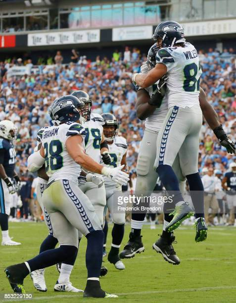 Luke Willson of the Seattle Seahawks celebrates with teammates after scoring a touchdown against the Tennessee Titans during the second half at...