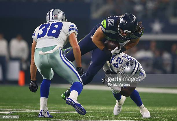 Luke Willson of the Seattle Seahawks is tackled by Jeff Heath and Morris Claiborne of the Dallas Cowboys in the second quarter at AT&T Stadium on...