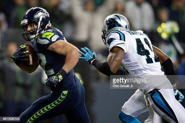 Luke Willson of the Seattle Seahawks runs the ball for a 25 yard touchdown in the fourth quarter against the Carolina Panthers during the 2015 NFC...