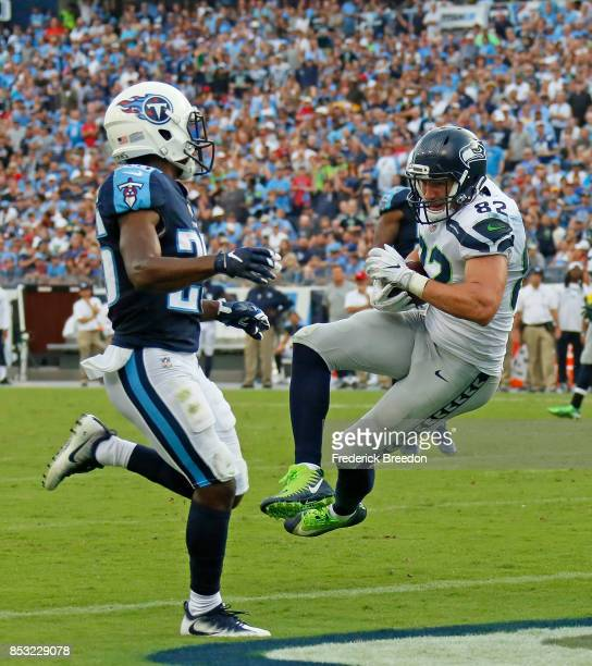 Luke Willson of the Seattle Seahawks scores a touchdown against the Tennessee Titans during the second half at Nissan Stadium on September 24 2017 in...