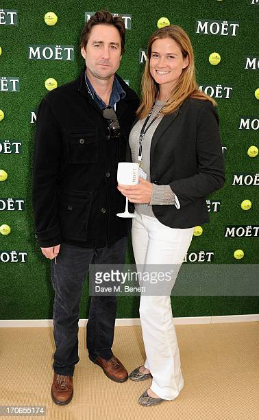 Luke Wilson and Meg Simpson attend The Moet Chandon Suite at The Aegon Championships Queens Club finals on June 16 2013 in London England