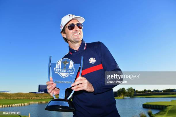 Luke Wilson of Team USA celebrates victory with the trophy after the celebrity challenge match ahead of the 2018 Ryder Cup at Le Golf National on...