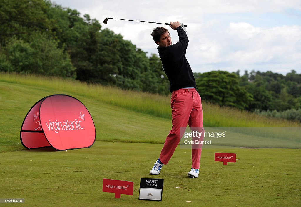 Luke Wilson tees off on the 13th hole during the Affinity Real Estate Shooting Stars Second Round at The Grove Hotel on June 15, 2013 in Hertford, England.