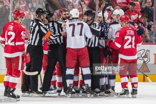 Luke Witkowski of the Detroit Red Wings and Josh Anderson of the Columbus Blue Jackets have words after the play during an NHL game at Little Caesars...