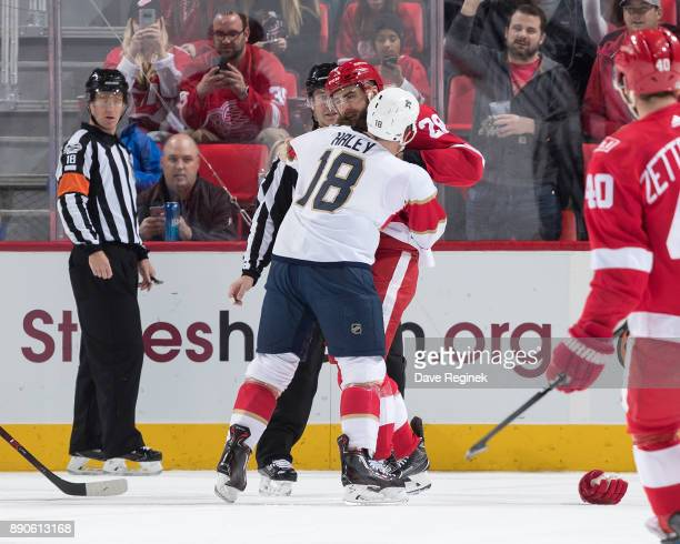 Luke Witkowski of the Detroit Red Wings drops gloves with Micheal Haley of the Florida Panthers during an NHL game at Little Caesars Arena on...