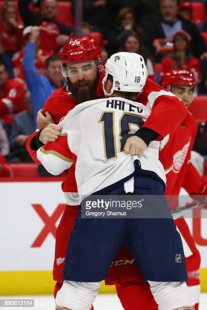 Luke Witkowski of the Detroit Red Wings fights Micheal Haley of the Florida Panthers during the first period at Little Caesars Arena on December 11...