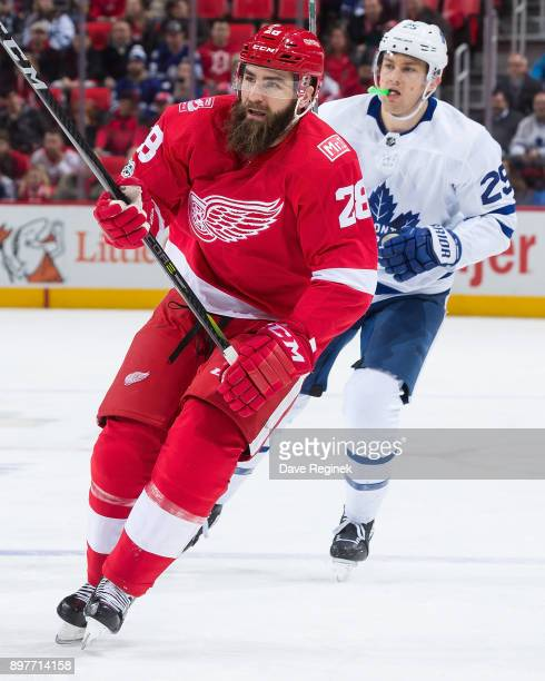 Luke Witkowski of the Detroit Red Wings skates up ice in front of James van Riemsdyk of the Toronto Maple Leafs during an NHL game at Little Caesars...