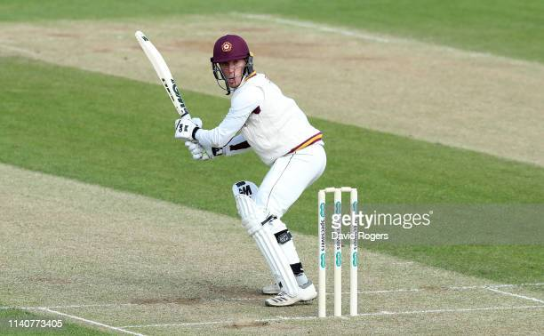 Luke Wood of Northamptonshire cuts the ball during the Specsavers County Championship division two match between Northamptonshire and Middlesex at...