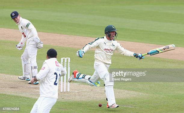 Luke Wood of Nottinghamshire celebrates scoring a century during the LV County Championship match between Nottinghamshire and Sussex at Trent Bridge...